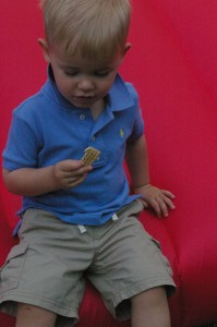 D eating hummus and crackers at his 2nd birthday party.  This kid loves hummus.